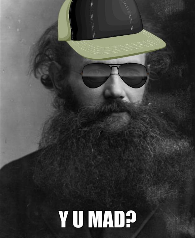 Petr Kropotkin - duchovní otec anarchokomunismu a tvář plakátu, který visí v redakci Houpacího Osla nad společnou ledničkou.